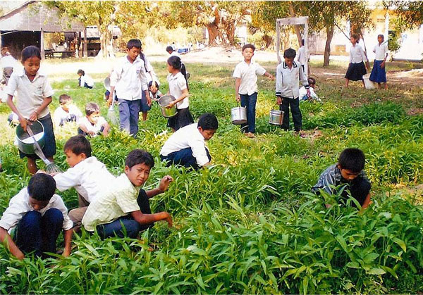 Ang Village children's school garden. A dug well built in the schoolyard makes it possible for students to keep a school garden to feed themselves and their families.