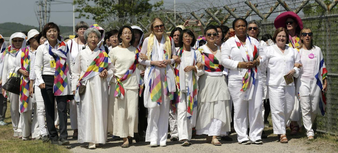 International women activists including Gloria Steinem and two Nobel Peace laureates on Sunday were denied an attempt to walk across the Demilitarized Zone dividing North and South Korea, but were allowed to cross by bus and complete what one of them called a landmark peace event. (AP Photo/Lee Jin-man)